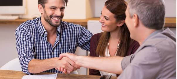 couple-shaking-hand-to-financial-agent-picture-id505472662-1